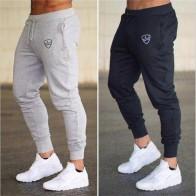 € 4.81 43% de DESCUENTO|Otoño de 2018 marca gimnasios hombres corredores chándal hombres chándal Pantalones deportivos ropa de la alta calidad pantalones de sueltas en Pantalones de chándal de La ropa de los hombres en AliExpress.com | Alibaba Group