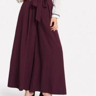 Середины талии завязывается поясом юбка брюки
