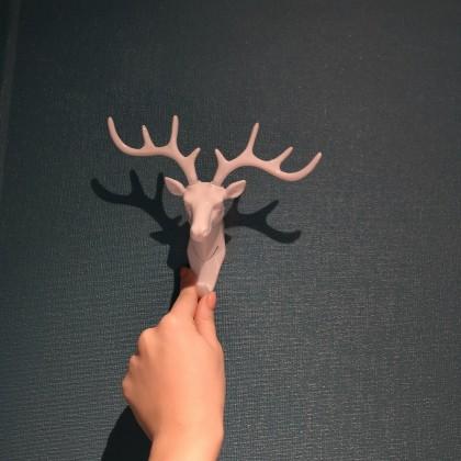 Крючок в виде головы оленя